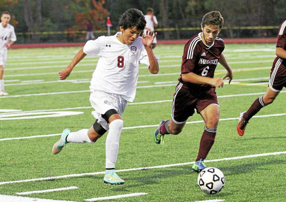 Torrington's Kevin Vaca, left, and  Naugatuck's Diogo Cruz race for control of the ball Wednesday night. Photo: Marianne Killackey — Special To Register Citizen  / 2014