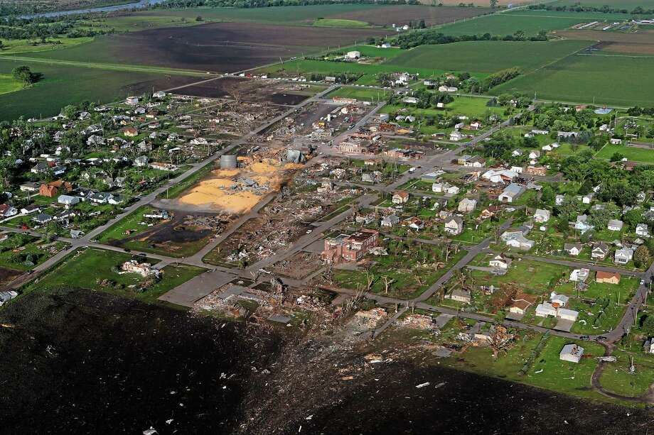 This Tuesday, June 17, 2014, aerial photo,  shows the devastated town of Pilger, Neb.  On Monday, a storm packing rare dual tornadoes tore through the tiny farming town in northeast Nebraska, killing a 5-year-old girl, leaving grain bins crumpled like discarded soda cans and flattening dozens of homes. Photo: (AP Photo/Dakota Aerials, Dave Tunge) / Dakota Aerials
