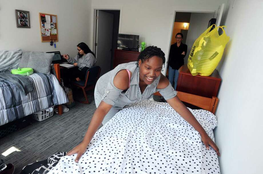 UConn Stamford freshman Snezana Johnson, 18, begins to organize her room inside the new Washington Boulevard dorms in downtown Stamford, Conn. on Sunday, August 27, 2017. Also pictured is 18-year-old roommmate Sara Laracca, of Trumbull, who completed moving in on Saturday. Photo: Michael Cummo / Hearst Connecticut Media / Stamford Advocate