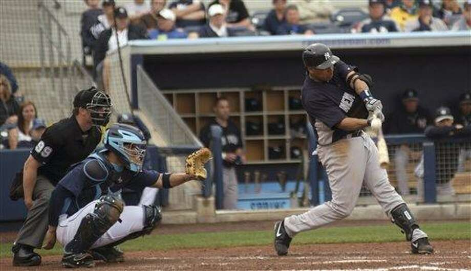 New York Yankees' Juan Rivera fouls off a pitch while batting against the Tampa Bay Rays during a baseball spring training game Tuesday, March 12, 2013, at Charlotte Sports Park in Port Charlotte, Fla. (AP Photo/Charlotte Sun, Katherine Godina) Photo: ASSOCIATED PRESS / AP2013