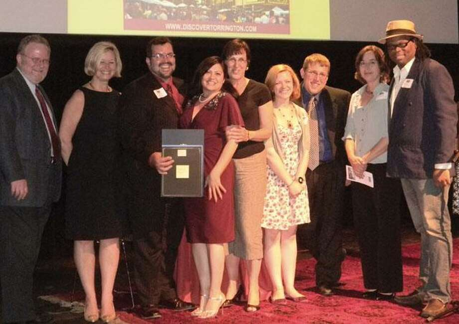 Jacque Williams, far right, was honored along with the Torrington Arts and Culture Commission in 2011 at the CT Main Street Awards Gala for the commission's work with Main Street Marketplace. File photo.