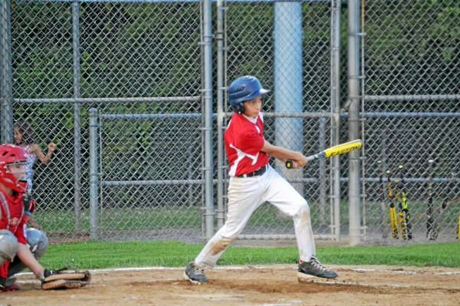 Pete Paguaga - Register Citizen  Torrington's CJ Root rips an RBI double in the third inning. Root went 2-for-2 in Torrington's 18-3 loss.