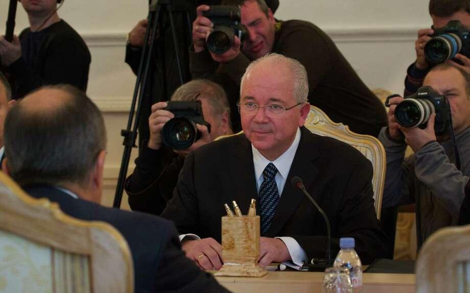 Venezuelan Foreign Minister Rafael Ramirez listens to Russian Foreign Minister Sergey Lavrov, left, during talks in Moscow, Russia, Wednesday, Oct. 8, 2014. (AP Photo/Ivan Sekretarev) Photo: AP / AP