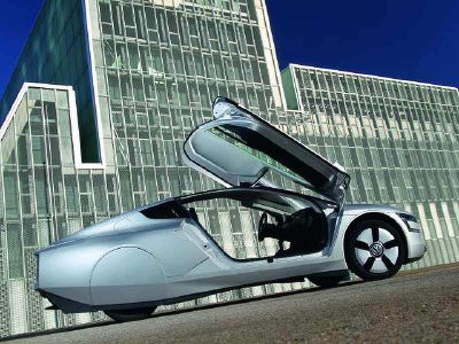 The XL1, launched in Geneva this year, is capable of traveling for 100km on 0.9 liters of fuel, thanks to hybrid technology.