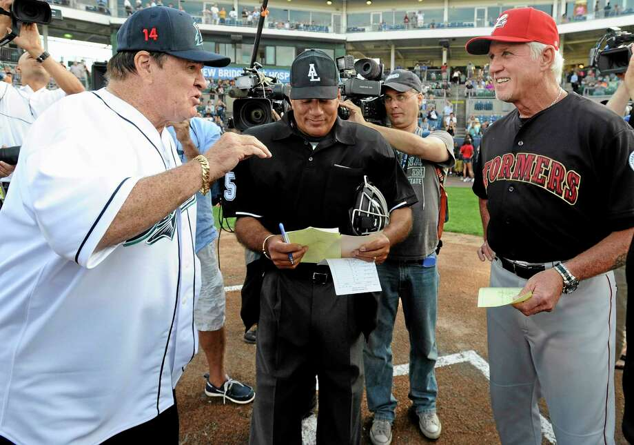 Pete Rose, left, and Lancaster Barnstormers manager Butch Hobson, right, talk at home plate before Monday's game at The Ballpark at Harbor Yard in Bridgeport. Photo: Jessica Hill — The Associated Press  / FR125654 AP