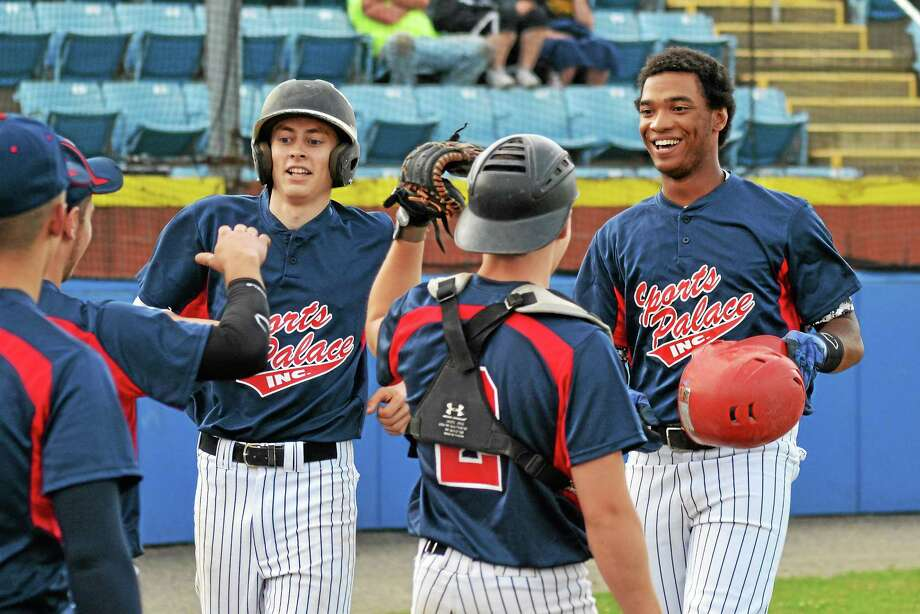 Torrington Sports Palace waits to give Manny Rijo (right) high-fives after hitting a two-run home run in the first inning of Torrington's 7-1 win over New Milford. Photo: Pete Paguaga — Register Citizen