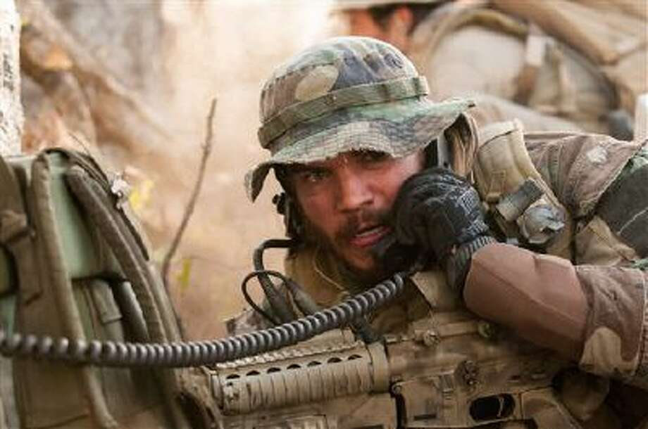 "This photo released by Universal Pictures shows Emile Hirsch as Danny Dietz in a scene from the film, ?Lone Survivor."" Photo: AP / Universal Pictures"