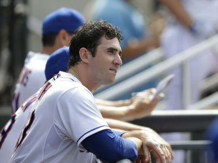 New York Mets starting pitcher Matt Harvey (33) watches the eighth inning from the dugout after pitching a seven-inning, three-hit shutout against the Philadelphia Phillies in a baseball game Sunday, July 21, 2013, in New York. Photo: AP / AP