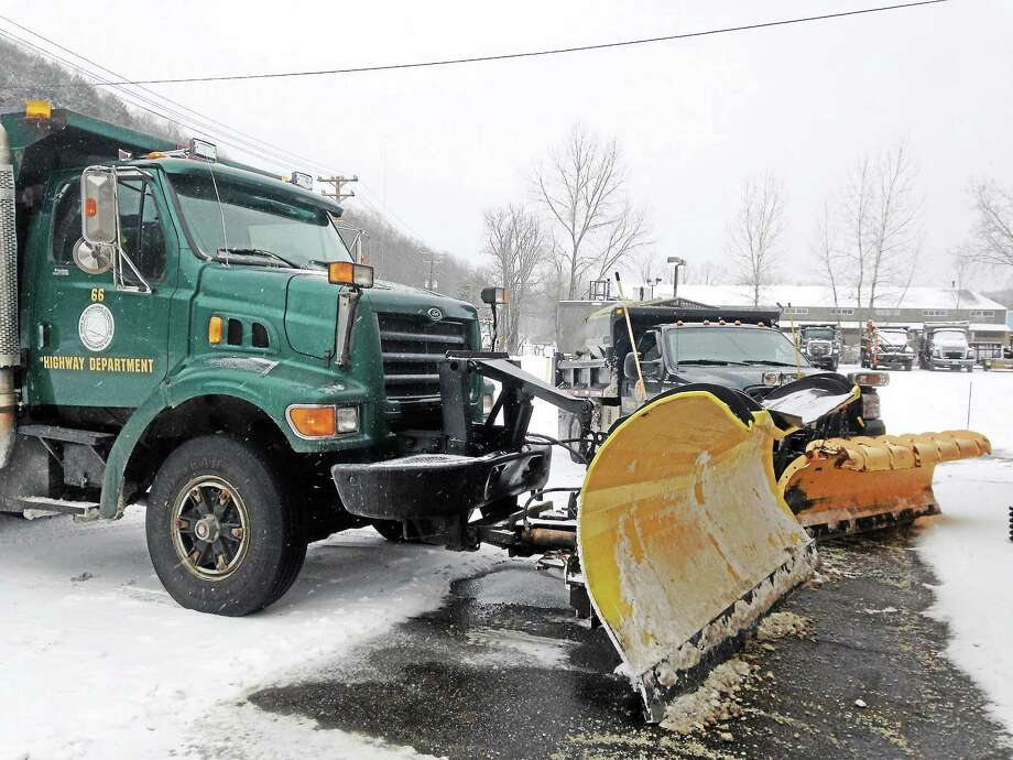 Plows parked outside the Winsted Department of Public Works Thursday before traveling along their routes. Photo: Mercy Quaye—Register Citizen