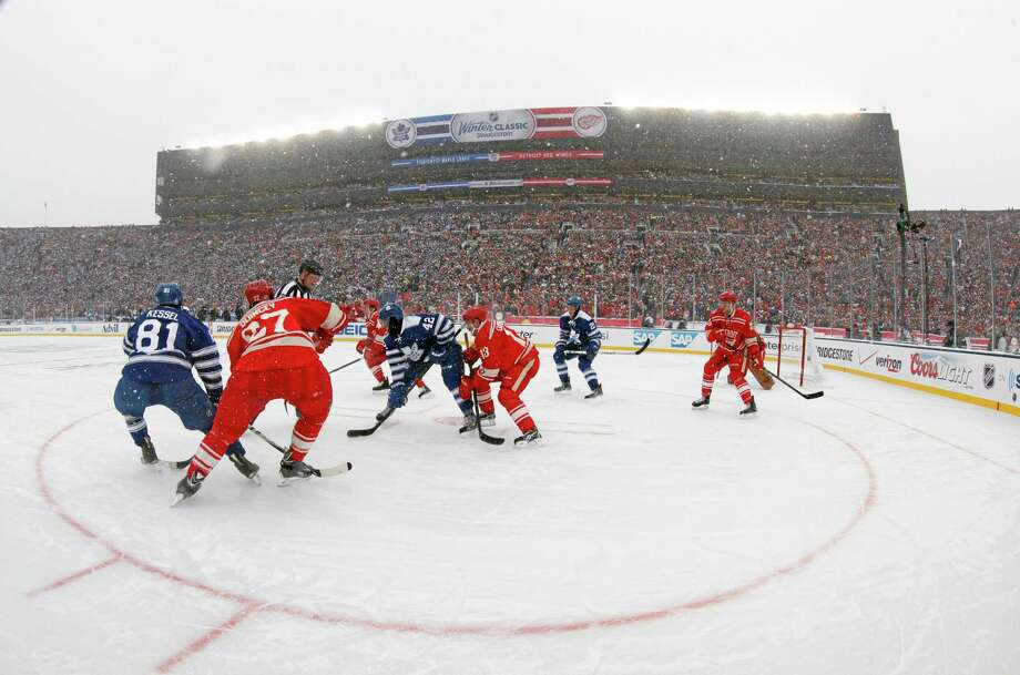 The Toronto Maple Leafs and the Detroit Red Wings face off during the first period of the NHL Winter Classic on Wednesday at Michigan Stadium in Ann Arbor. Photo: Paul Sancya — The Associated Press  / AP