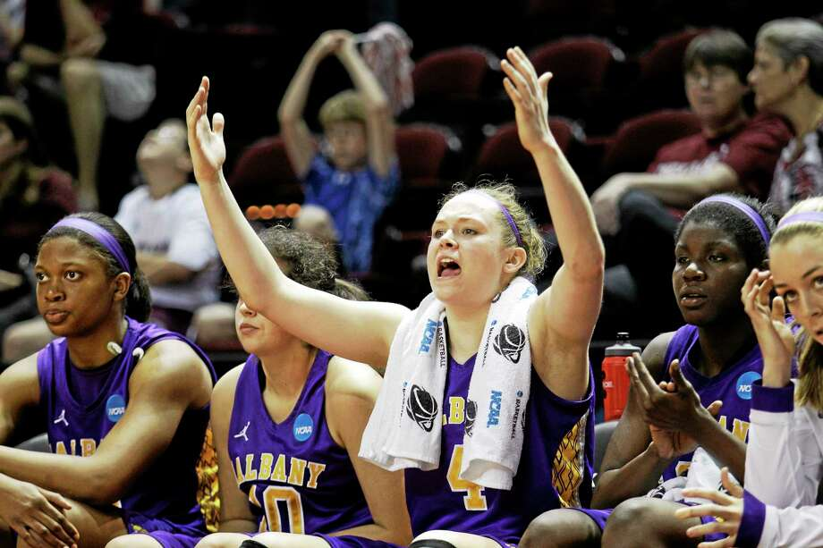 Albany's Sarah Royals (4) raises her hands during the second half of an NCAA tournament first-round game last season. Photo: David J. Phillip — The Associated Press  / AP