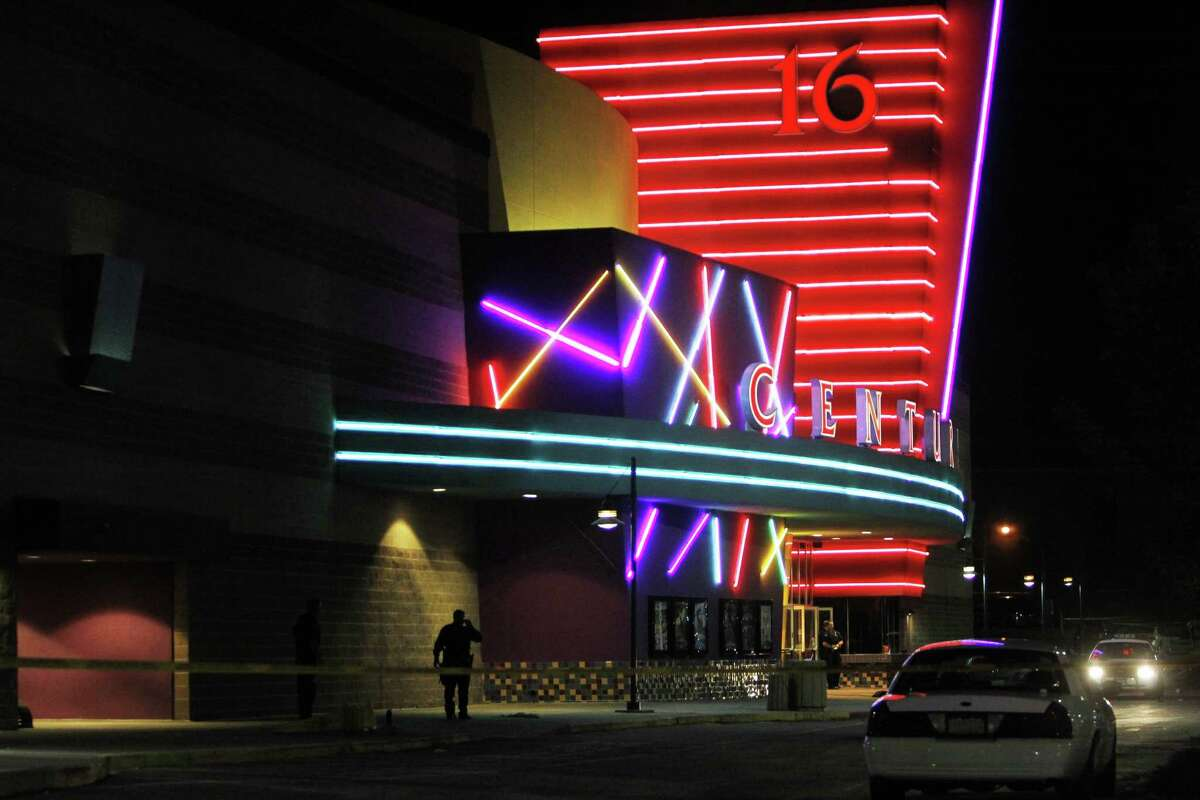 File - In this July 20, 2012 file photo, police are pictured outside of a Century 16 movie theatre where as many as 14 people were killed and many injured at a shooting during the showing of a movie at the in Aurora, Colo. Medical personnel responding to the Colorado theater shooting struggled to get to some of the victims due to poor communication about how best to reach them, a report released Wednesday, Oct. 8, 2014 said.