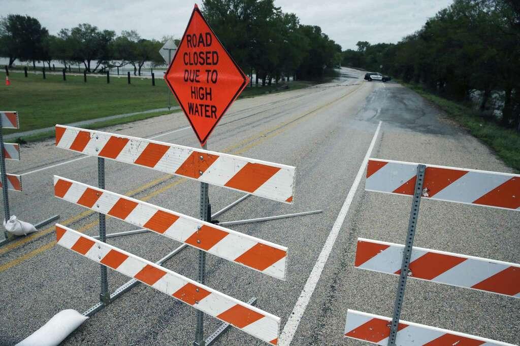 Barricades block a county road near Cedar Creek as Hurricane Harvey hits the countryside east of