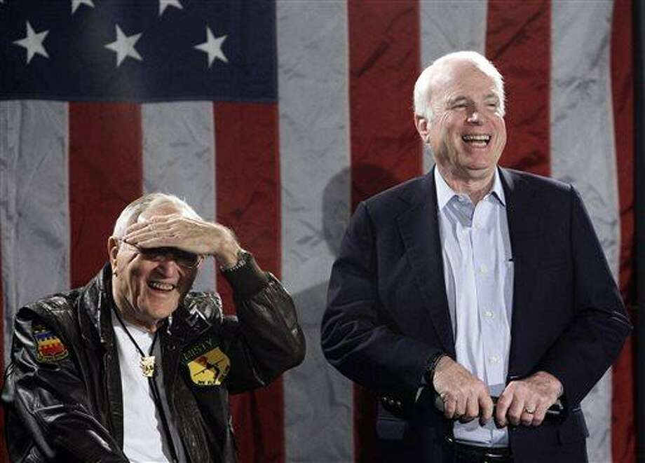 """In this Feb. 18, 2010, file photo, retired Col. George """"Bud"""" Day, left, laughs with Arizona Sen. John McCain at a Veterans Town Hall Meeting and endorsement news conference at the American Legion Post #1 Luke-Greenway in Phoenix. Day, a Medal of Honor recipient who spent 5? years as a POW in Vietnam and was Arizona Sen. John McCain's cellmate, died Saturday, July 27, 2013, after a long illness. He was 88. (AP Photo/Ross D. Franklin, File) Photo: AP / AP"""