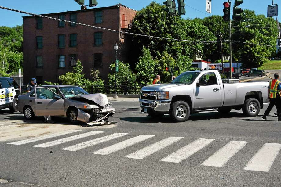 The scene of a two-car accident at the intersection of Main and Elm streets on Monday afternoon in Winsted. No injuries were reported at the scene, according to police. Photo: Ryan Flynn — The Register Citizen