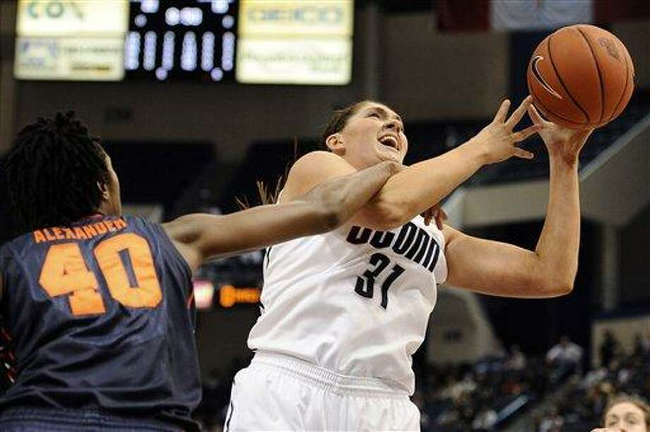 Connecticut's Stefanie Dolson, right, is fouled by Syracuse's Kayla Alexander in the first half of an NCAA college basketball game in the semifinals of the Big East Conference women's tournament in Hartford, Conn., Monday, March 11, 2013. (AP Photo/Jessica Hill) Photo: ASSOCIATED PRESS / A2013