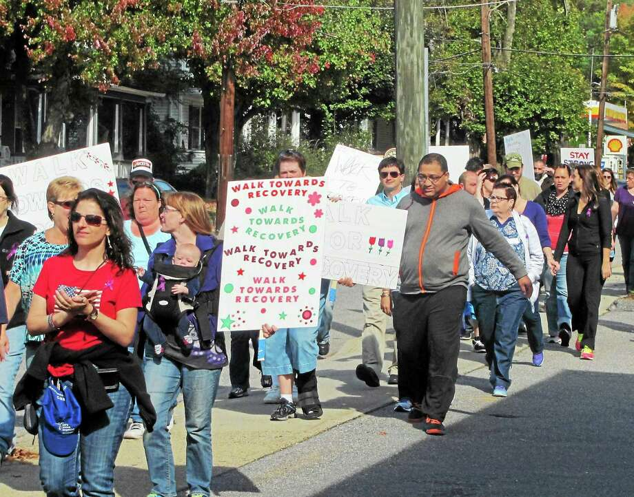 More than 70 walkers participated in the Walk Towards Recovery down Main Street in Torrington Wednesday to raise awareness of mental health issues. Photo: John Nestor — Special To The Register Citizen