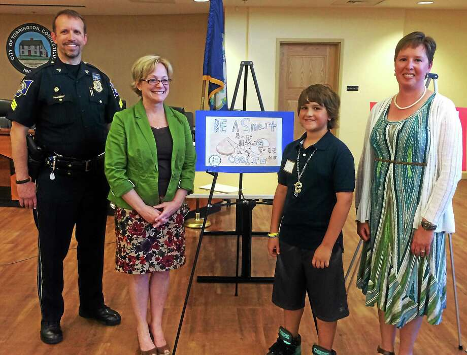 Torrington Police Sgt. Linas Venclauskas, Mayor Elinor Carbone, Tar Wars poster contest winner Matthew Embrey, and Dr. Stephanie Fowler, Chartlotte Hungerford Hospital board member and CT Academy of Family Physicians Tar Wars Coordinator. Photo: Contributed Photo