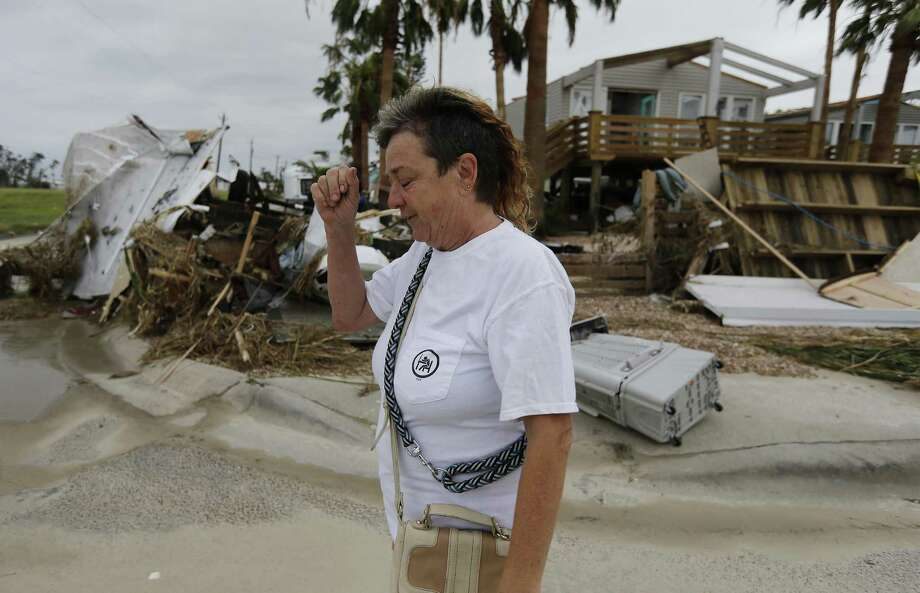 Janet Calvert walks past homes that were destroyed in the aftermath of Hurricane Harvey in Port Aransas, Texas on Sunday, Aug. 27, 2017. Calvert was amongst several residents who decided to stay instead of evacuating the the port town that was eventually struck by the category four storm. (Kin Man Hui/San Antonio Express-News) Photo: Kin Man Hui, Staff / San Antonio Express-News / ©2017 San Antonio Express-News
