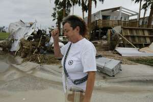Janet Calvert walks past homes that were destroyed in the aftermath of Hurricane Harvey in Port Aransas, Texas on Sunday, Aug. 27, 2017. Calvert was amongst several residents who decided to stay instead of evacuating the the port town that was eventually struck by the category four storm. (Kin Man Hui/San Antonio Express-News)