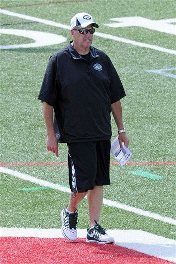 New York Jets coach Rex Ryan watches practice at their NFL football training camp on Sunday, July 28, 2013, in Cortland, N.Y. (AP Photo/Bill Kostroun) Photo: AP / FR51951 AP