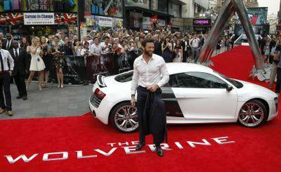 """Actor Hugh Jackman poses at the UK Premiere of """"The Wolverine"""" at Leicester Square in London July 16, 2013. Photo: REUTERS / X01981"""