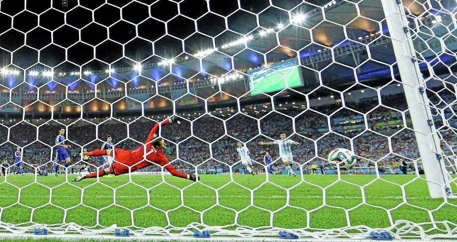 Bosnia's goalkeeper Asmir Begovic looks to the ball as Argentina's Lionel Messi scores his side's second goal on Sunday. Photo: Victor R. Caivano — The Associated Press  / AP