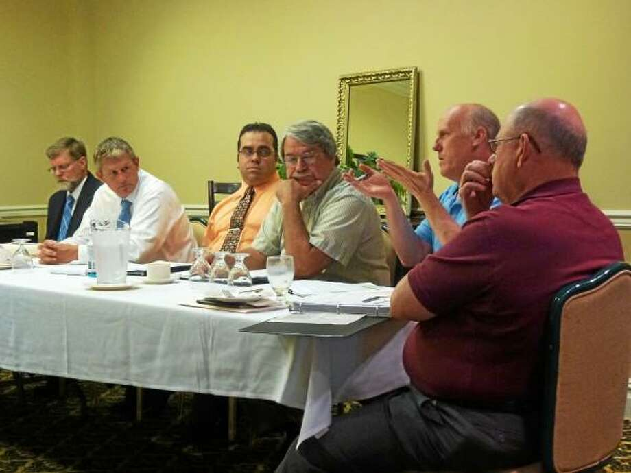 DEEP's Tom Metzner explains new recycling initiatives to Goshen First Selectman Wilrose Duquette, Harwinton First Selectman Michael Criss and other local leaders during an LHCEO meeting on July 12. (Ryan Flynn-Register Citizen)