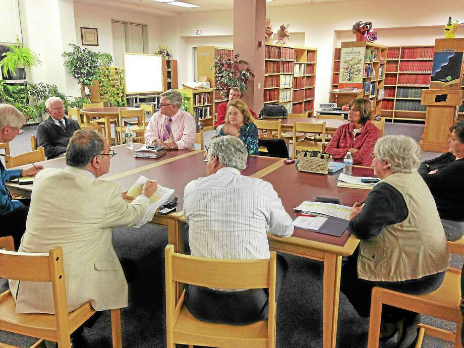 Mercy Quaye-Register Citizen ¬ Members of the Winchester board of education and the Gilbert Trust met Thursday night to discuss the 2014-15 contract. Photo: Journal Register Co.