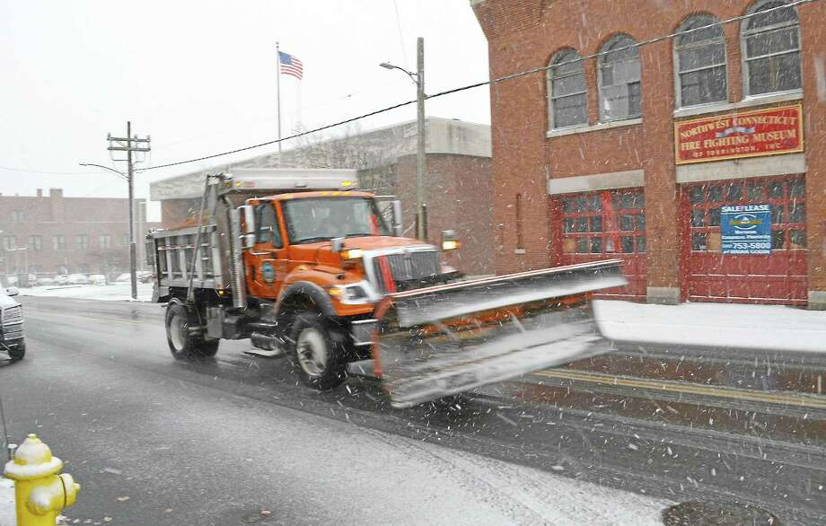 Plows on the road in Torrington during a snow storm in 2013. Photo: Register Citizen File Photo