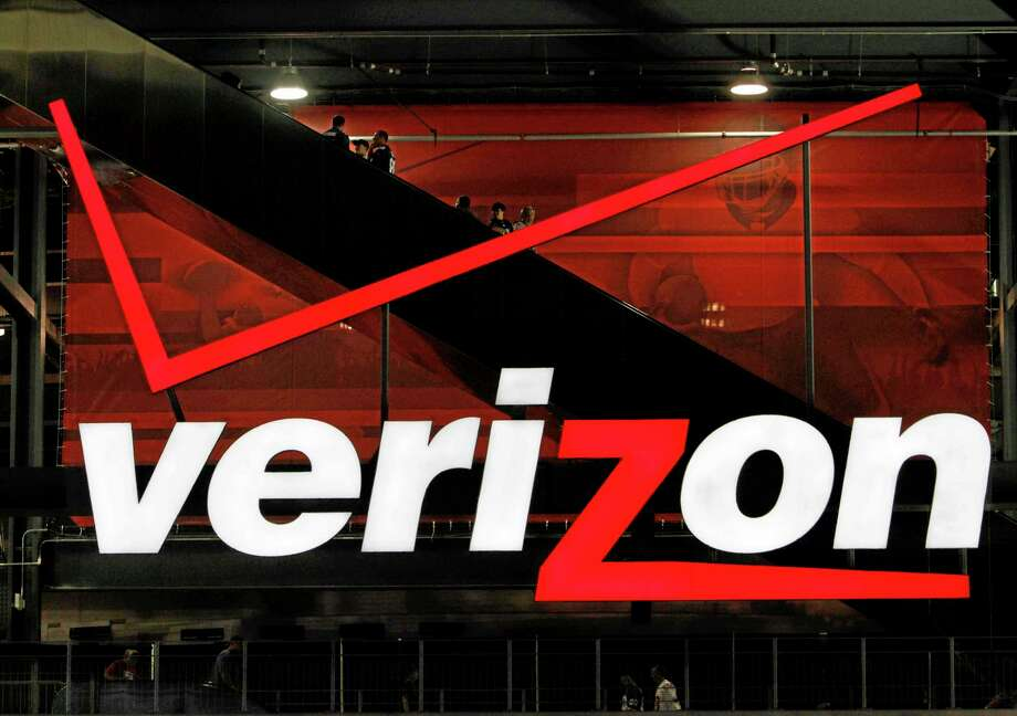 FILE - In file photo taken Aug. 21, 2010, a Verizon sign is shown at New Meadowlands Stadium in East Rutherford, N.J. On Tuesday, Jan. 14, 2014 a three-judge panel of the U.S. Court of Appeals for the D.C. Circuit affirmed that the FCC had authority to create open-access rules. But in a setback for the Obama administration's goal of Internet openness, the court ruled that the FCC failed to establish that its 2010 regulations don't overreach. Under so-called net neutrality rules adopted in 2010 by the Federal Communications Commission, wired broadband providers such as Comcast, Time Warner Cable and Verizon were barred from prioritizing some types of Internet traffic over others.(AP Photo/Peter Morgan) Photo: AP / AP