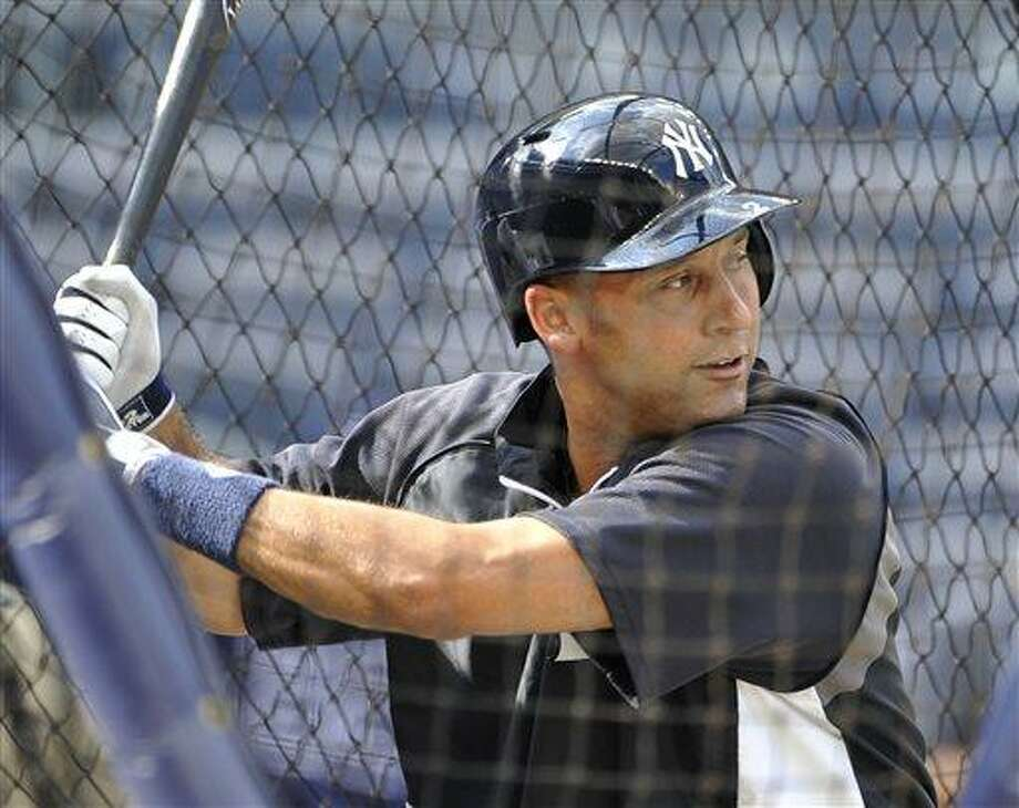 New York Yankees' Derek Jeter takes batting practice before the Yankees' baseball game against the Tampa Bay Rays at Yankee Stadium on Friday, July 26, 2013, in New York. (AP Photo/Kathy Kmonicek) Photo: AP / FR170189 AP