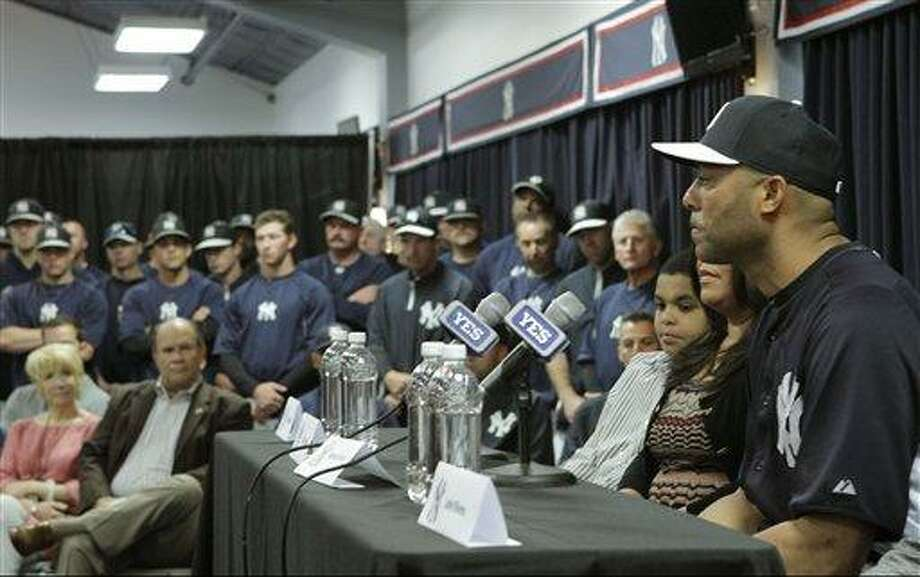 Yankees front office, coaches and teammates listen as New York Yankees pitcher Mariano Rivera, far right, who holds baseball's all-time saves record, announces his plans to retire at the end of the 2013 season during a news conference at Steinbrenner Field Saturday, March 9, 2013 in Tampa, Fla. (AP Photo/Kathy Willens) Photo: ASSOCIATED PRESS / AP2013