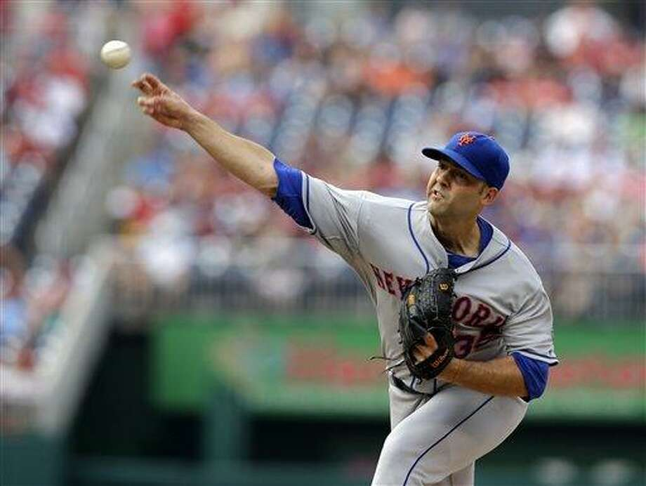 New York Mets starting pitcher Dillon Gee (35) throws during a baseball game against the Washington Nationals at Nationals Park Saturday, July 27, 2013, in Washington. (AP Photo/Alex Brandon) Photo: AP / AP