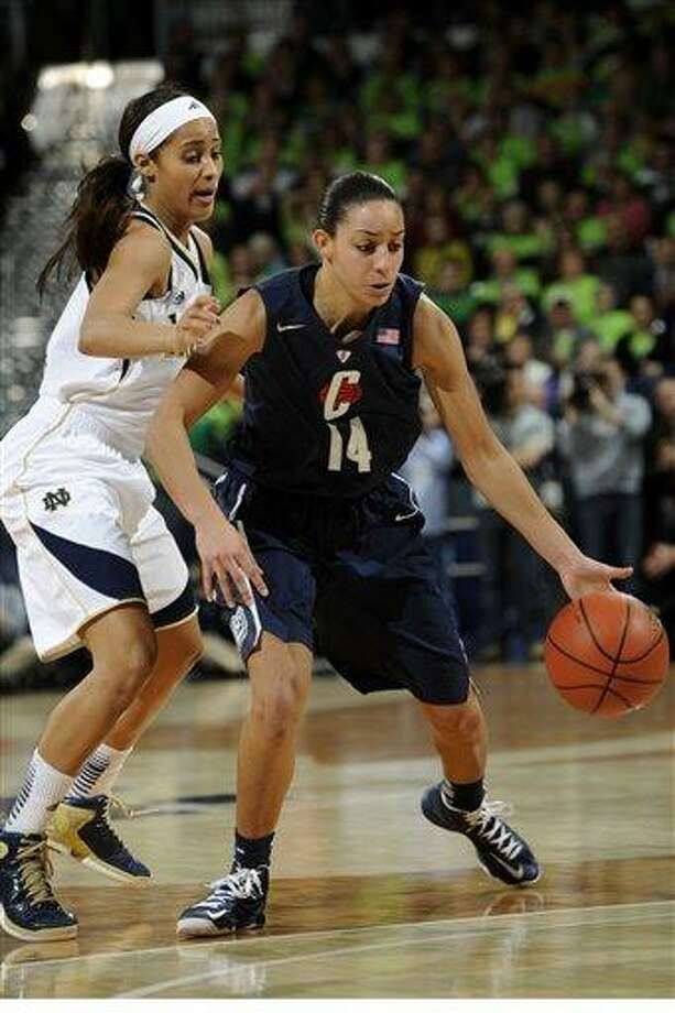 Connecticut guard Bria Hartley, right, drives past Notre Dame guard Skylar Diggins in a college basketball game Monday March 4, 2013 in South Bend, Ind. (AP Photo/Joe Raymond) Photo: ASSOCIATED PRESS / AP2013