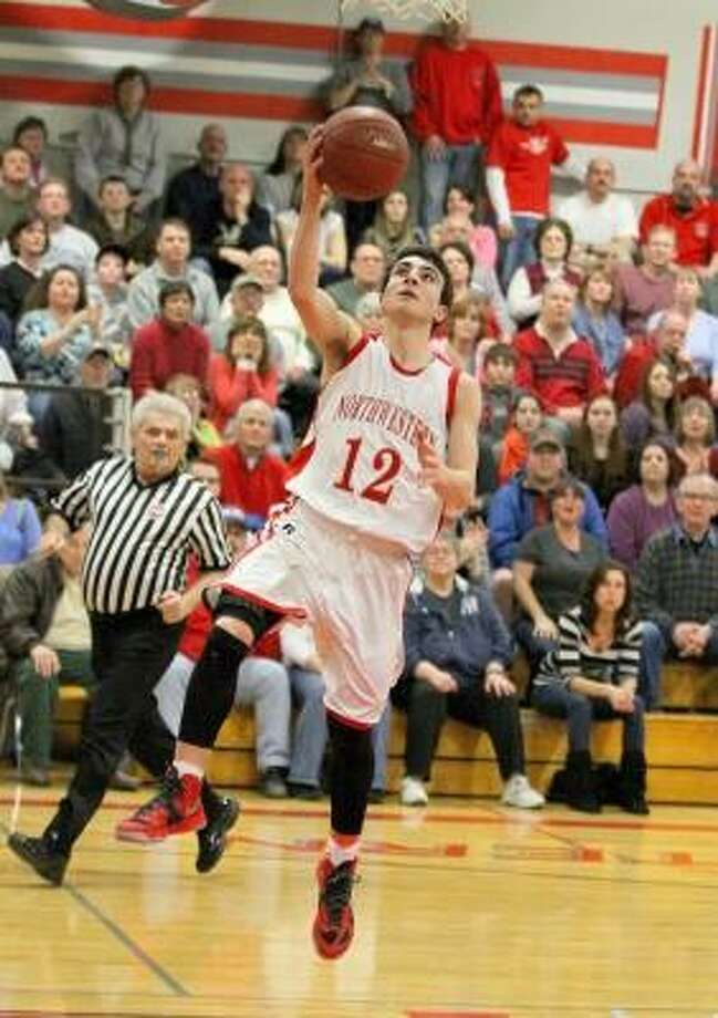 Marianne Killackey/Special to the Register Citizen The Highlandersí Arthur Lefevre (12) puts in a layup. / 2013