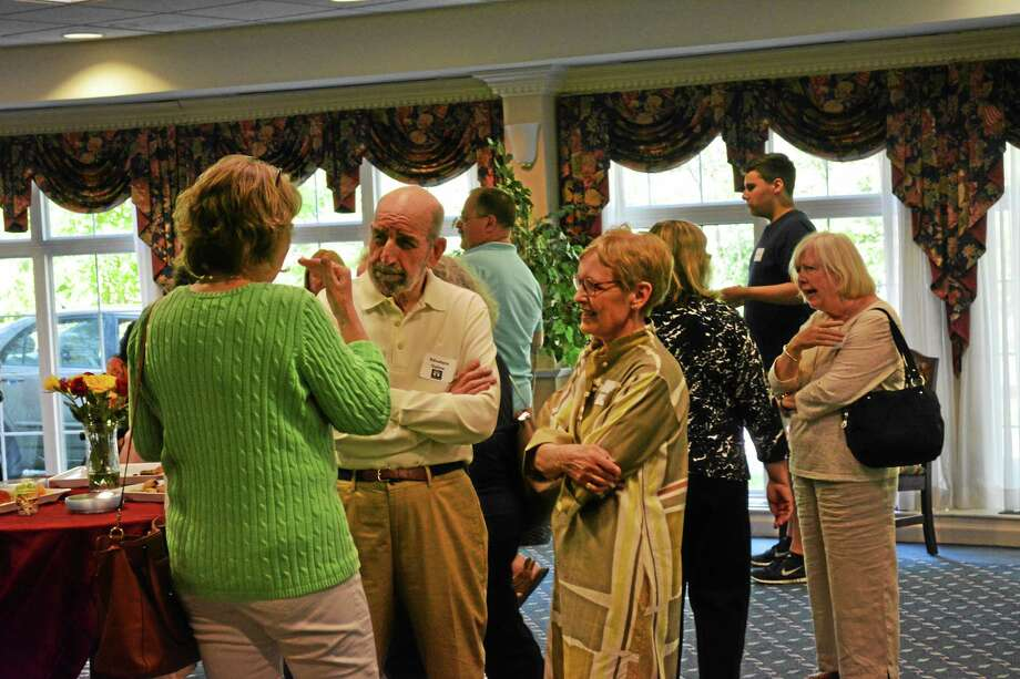 Artists got a chance to mingle with other locals during the preview party. Photo: Ryan Flynn - THe Register Citizen