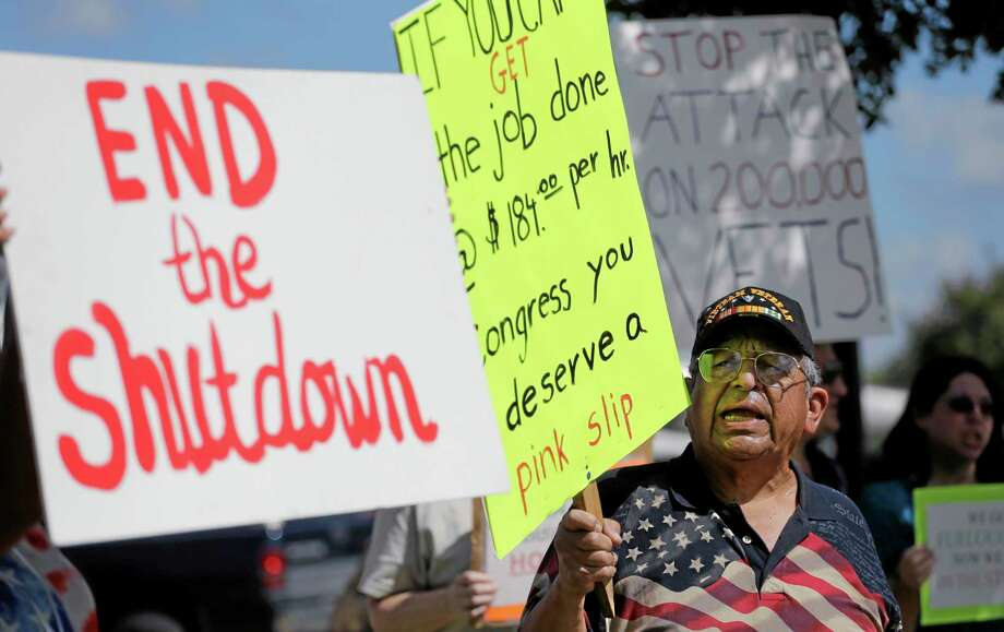 Veteran Raul Sanchez protests for federal workers idled by the government shutdown outside the San Antonio office of U.S. Sen. Ted Cruz, R-Texas, Thursday, Oct. 3, 2013, in San Antonio. (AP Photo/Eric Gay) Photo: AP / AP