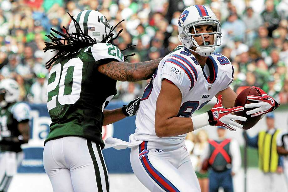Buffalo Bills wide receiver David Nelson reacts after catching a touchdown in front of New York Jets defensive back Kyle Wilson during a Nov. 27, 2011, game in East Rutherford, N.J. Photo: Kathy Willens — The Associated Press  / AP2011