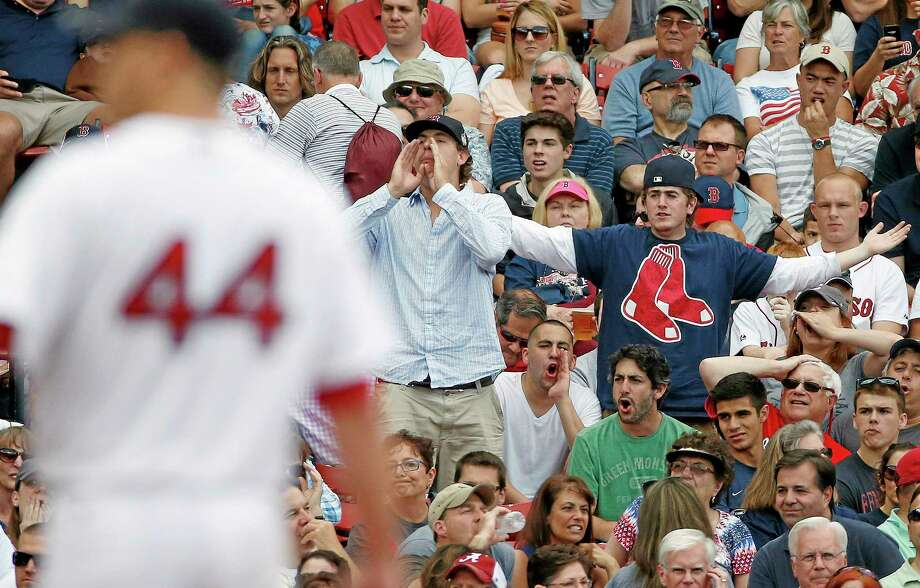 Fans react after Red Sox pitcher Jake Peavy walked the Cleveland Indians' Lonnie Chisenhall to load the bases during the fifth inning of Saturday's game in Boston. Photo: Michael Dwyer — The Associated Press  / AP