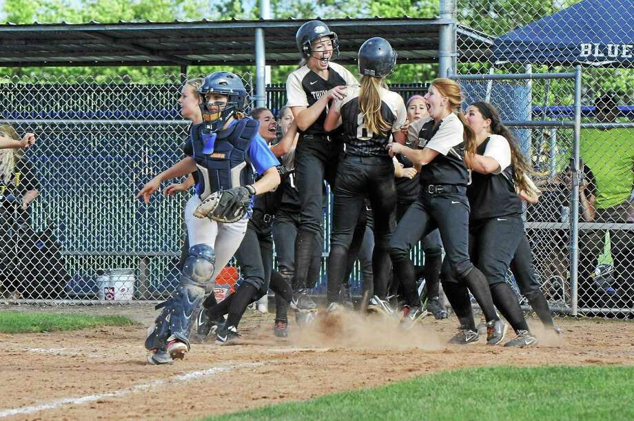 Thomaston swarms Gabby Hurlbert (8) after she scored the game-winning run, on a Erin O'Neill base hit, in the bottom of the eighth to lift the Golden Bears past Old Saybrook to win the Class S state championship, 7-6. Photo: Laurie Gaboardi — Register Citizen