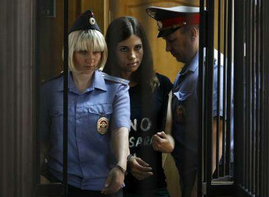 "Member of the female punk band ""Pussy Riot"" Nadezhda Tolokonnikova (C) is escorted before a court hearing to appeal for parole at the Supreme Court of Mordovia in Saransk, July 26, 2013. Tolokonnikova was sentenced to two years in prison for the band's performance against President Vladimir Putin at Moscow's main Russian Orthodox cathedral in 2012. REUTERS/Sergei Karpukhin (RUSSIA - Tags: POLITICS CRIME LAW CIVIL UNREST TPX IMAGES OF THE DAY ENTERTAINMENT) Photo: REUTERS / X00944"