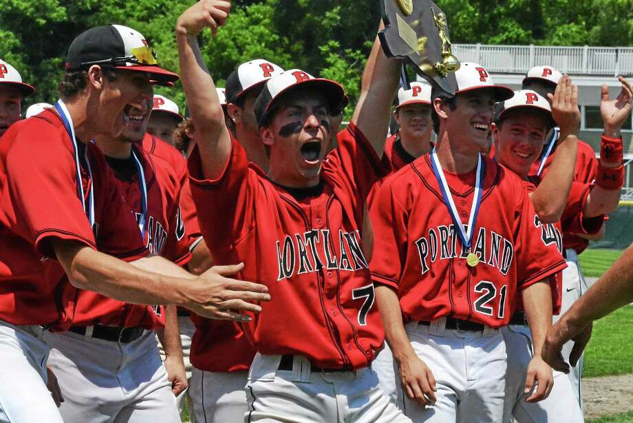 Portlandís Mike Bordonaro celebrates with the Class S state championship plaque after the Highlanders beat Thomaston, 8-0. Photo: Pete Paguaga — Register Citizen