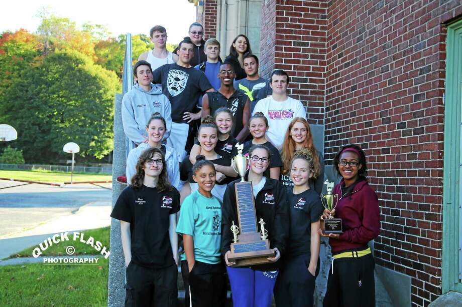 """Torrington High School seniors pose after the school's band, """"The Pride of Torrington,"""" took first place at the North Adams Foliage Parade, winning the """"Golden Harvest Award"""" for the fourth year in a row Sunday. Photo: Contributed Photo — William Donovan III — Quick Flash Photography"""