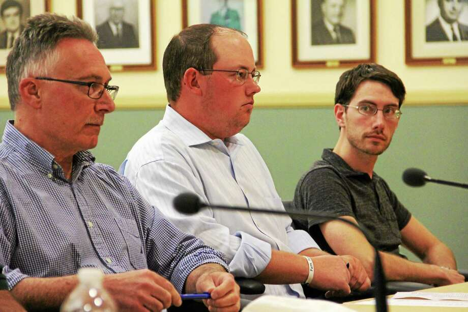 City Councilman Paul Cavagnero, left, with fellow council members Gregg Cogswell and Christopher Anderson during a meeting in June at City Hall in Torrington. Photo: Register Citizen File Photo