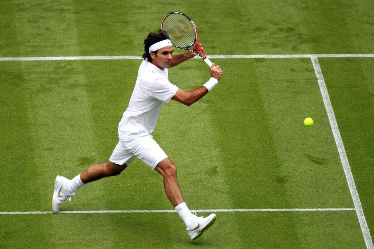 LONDON, ENGLAND - JUNE 21: Roger Federer of Switzerland in action during his first round match against Alejandro Falla of Columbiaon Day One of the Wimbledon Lawn Tennis Championships at the All England Lawn Tennis and Croquet Club on June 21, 2010 in London, England. (Photo by Julian Finney/Getty Images) *** Local Caption *** Roger Federer