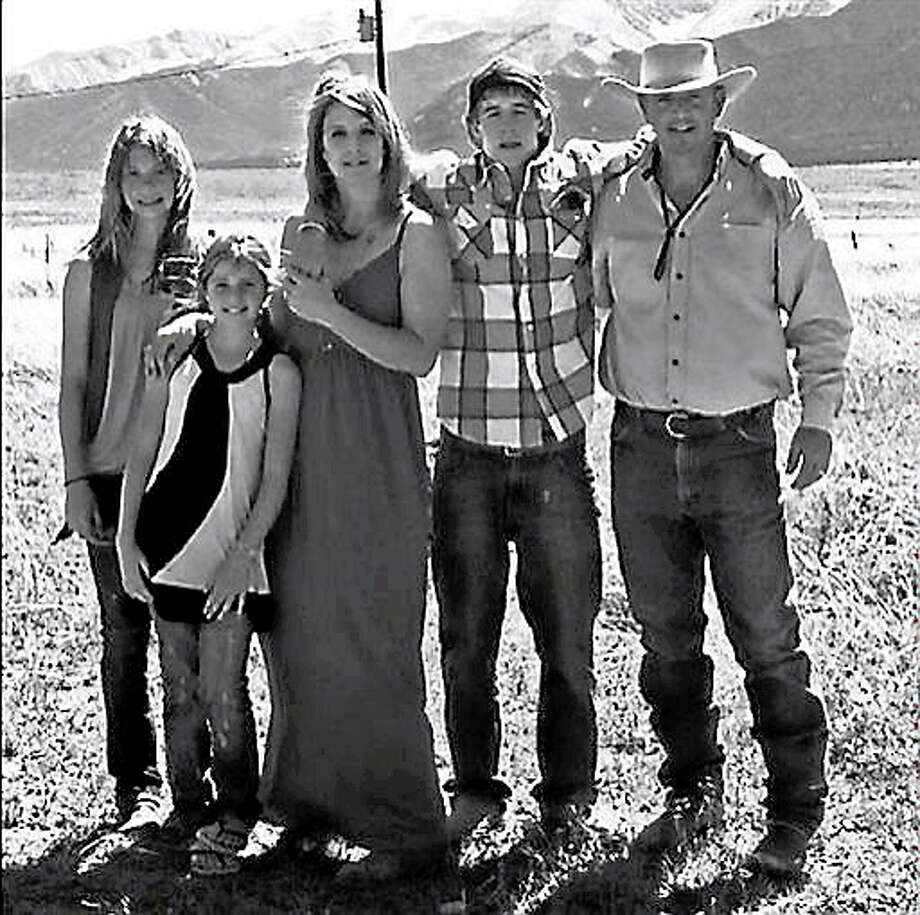 This 2012 photo provided by the Johnson family shows Dawna Johnson, 45, third left, and Dwayne Johnson, 46, right, with their children, from left, Kiowa-Rain Johnson, 18, Gracie Johnson, 13, and Dakota Johnson, in front of Mount Princeton in Colorado. Dwayne, Dawna and Kiowa-Rain Johnson were killed in Monday?s Sept. 30, 2013, rockslide near Buena Vista, Colo. Gracie Johnson was rescued from the rubble and hospitalized in Denver. Also killed were Baigen Walker, 10, and Paris Walkup, 22, both of Birch Tree, Mo. They were nephews of Dwayne and Dawna Johnson. (AP Photo/Johnson Family) Photo: AP / Johnson Family