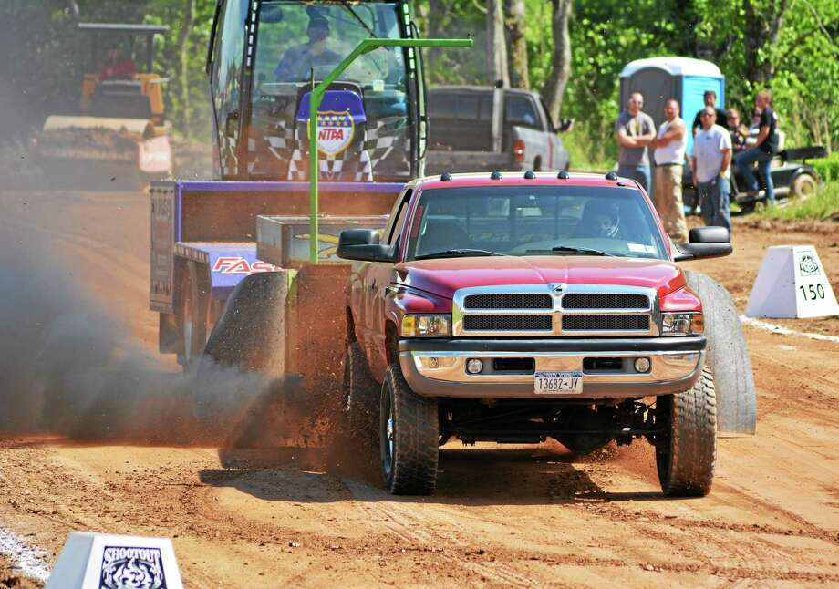 The tractor pull portion of the Goshen Stampede packed the stands Saturday afternoon. John Berry - The Register Citizen Photo: Journal Register Co.