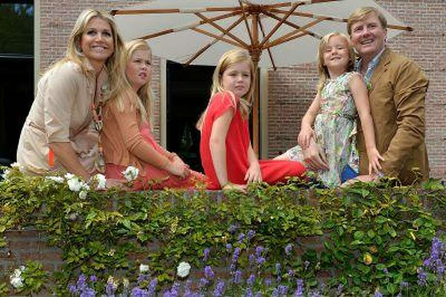 From left to right, Queen Maxima of the Netherlands, Crown Princess Catharina-Amalia of the Netherlands, Princess Alexia of the Netherlands, Princess Ariane of the Netherlands and King Willem-Alexander of the Netherlands pose during the annual summer photocall at Horsten Estate on July 19, 2013 in Wassenaar, Netherlands. Photo: Getty Images / 2013 Getty Images