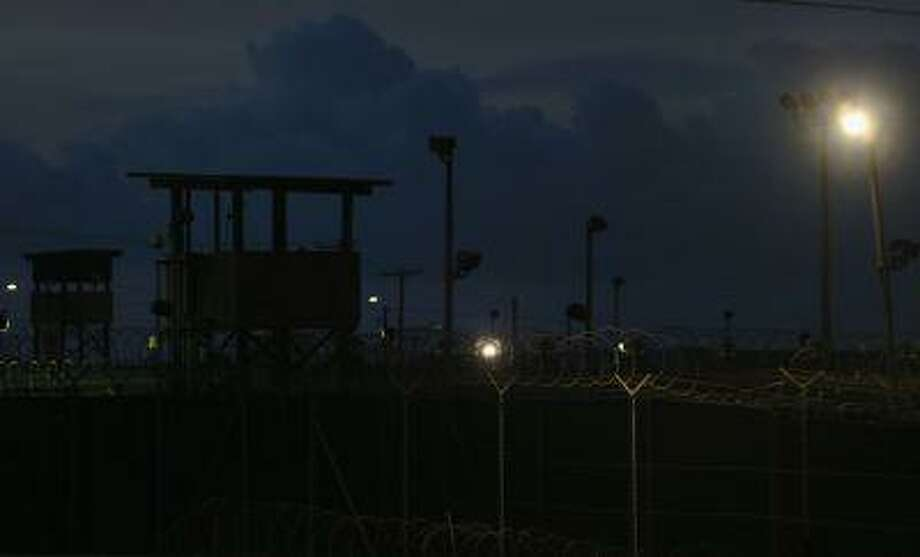 Razor wire and guard towers are seen at Camp Delta which is part of the U.S. military prison for 'enemy combatants' on June 26, 2013 in Guantanamo Bay, Cuba. Photo: Getty Images / 2013 Getty Images